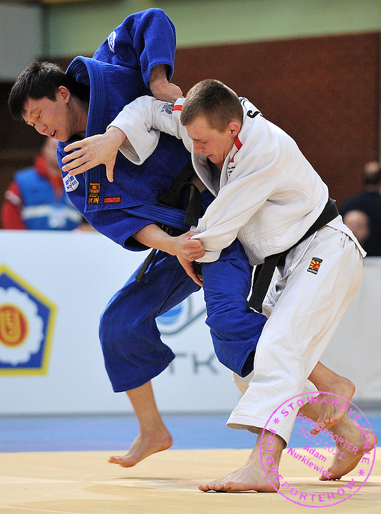 (WHITE) SEBASTIAN JANICKI (POLAND) & (BLUE) ARYSTAN SHAMENOV (KAZACHSTAN) DURING 60 KG WEIGHT CATEGORY FIGHT ON JUDO WORLD CUP MEN AT ARENA URSYNOW HALL IN WARSAW, POLAND...WARSAW , POLAND , FEBRUARY 28, 2009..( PHOTO BY ADAM NURKIEWICZ / MEDIASPORT )..PICTURE ALSO AVAIBLE IN RAW OR TIFF FORMAT ON SPECIAL REQUEST.