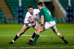 Freddie Steward of England U20 is challenged by Ethan McIlroy of Ireland U20 - Rogan/JMP - 21/02/2020 - Franklin's Gardens - Northampton, England - England U20 v Ireland U20 - Under 20 Six Nations.