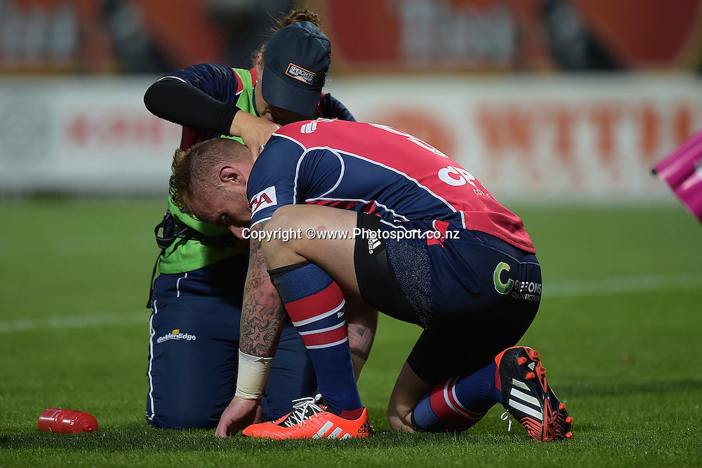 Tasman Makos Jimmy Cowan receives medical attention  during the ITM Cup Premiership Final between Taranaki & Tasman at Yarrow Stadium in New Plymouth, New Zealand, 25th October 2014. Photo: Marty Melville/Photosport.co.nz