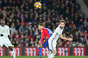 Daley Blind Midfielder of Manchester United beats Crystal Palace Midfielder James McArthur in the air with header during the Premier League match between Crystal Palace and Manchester United at Selhurst Park, London, England on 14 December 2016. Photo by Phil Duncan.