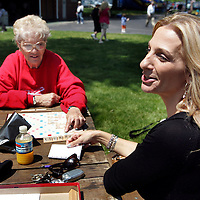 (PPAGE1) Monmouth Park 5/13/2006 L-R Frances Margino 72 of Roselle Park and Rose Hall 40 of Toms River neither who are gamblers play a game of scrabble outside the grandstand of Monmouth Park while racing takes place on the track  Michael J. Treola Staff Photographer.....MJT