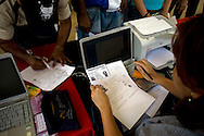 Venezuelan citizens stand in line to apply for ID card at The Fabricio Ojeda Nucleus of Endogenous Development. Mission Identidad is a program which provides Venezuelan national identity cards. Caracas, Oct. 18, 2008 (Photo/Ivan Gonzalez)