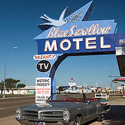 Blue Swallow Motel in Tucumcari, New Mexico with vintage Bonneville car