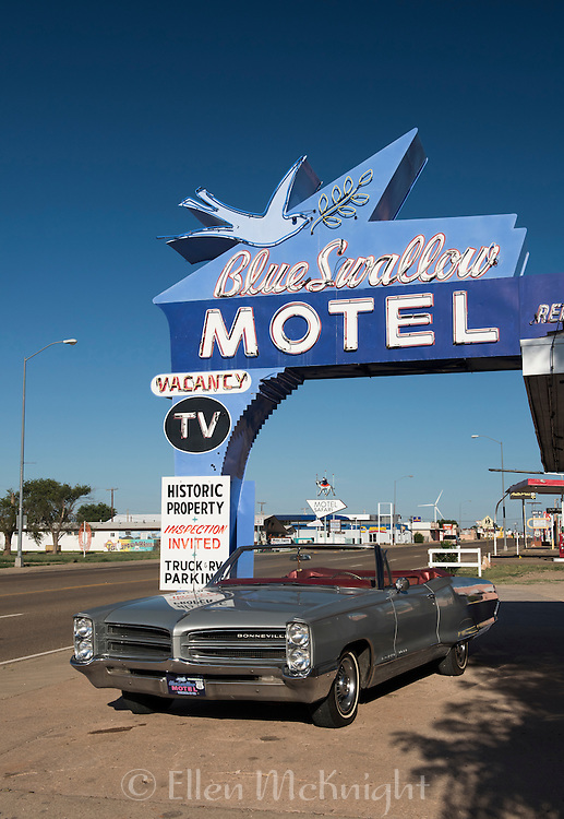 Blue Swallow Motel in Tucumcari, New Mexico with vintage Bonneville car