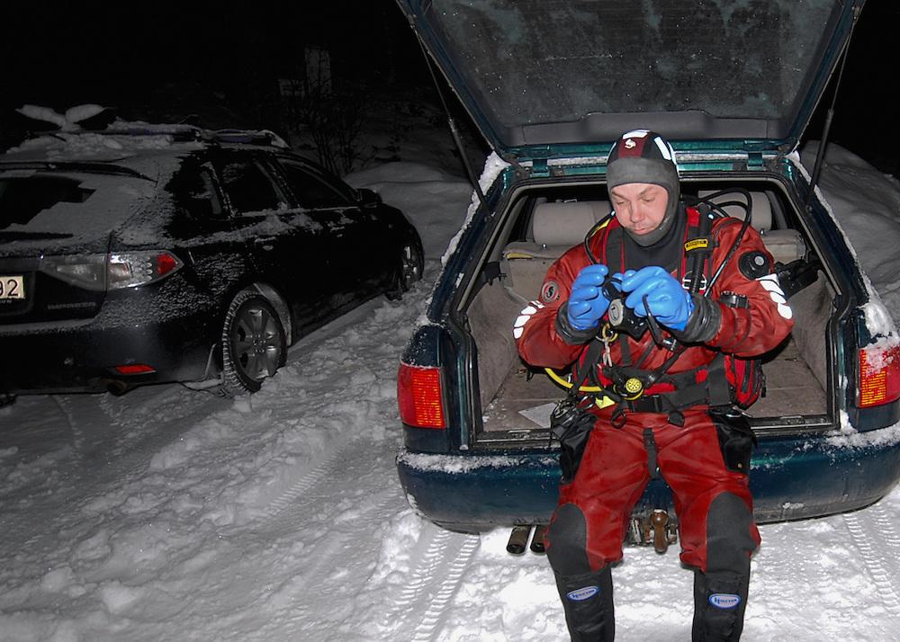 Photographer Magnus Lundgren at work in Trondheimsfjorden, Norway.Model release by photographer