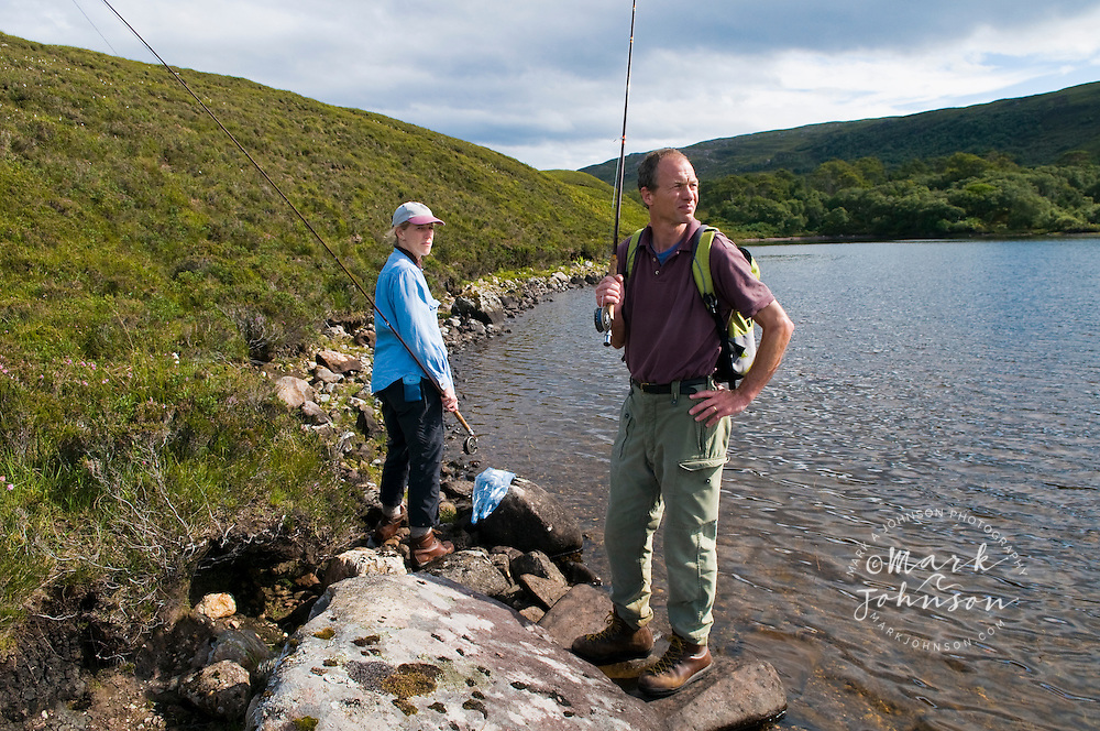 Couple flyfishing at Loch An Draing, Scotland, UK