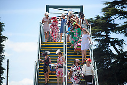 © Licensed to London News Pictures. 21/06/2018. London, UK. Racegoers wait to cross the road as they arrive for Ladies Day at Royal Ascot at Ascot racecourse in Berkshire, on June 21, 2018. The 5 day showcase event, which is one of the highlights of the racing calendar, has been held at the famous Berkshire course since 1711 and tradition is a hallmark of the meeting. Top hats and tails remain compulsory in parts of the course. Photo credit: Ben Cawthra/LNP