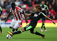 Stoke City's Mame Diouf and Bournemouth Nathan Ake battle for the ball