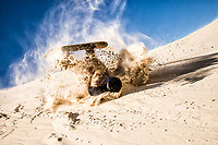 Sandboarder falling on the sand dunes of Praia Grande (Long Beach). Laguna, Santa Catarina, Brazil. / <br /> Sandboarder caindo na areia  das dunas da Praia Grande. Laguna, Santa Catarina, Brasil.