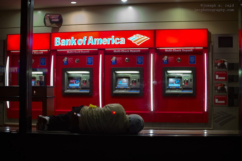 Man sleeping in bank ATM vestibule