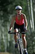 A Woman riding along a trail / MTB<br /> Leisure - Cycling / MTB ( Model Released )<br /> &copy; Sport the library/David Epperson