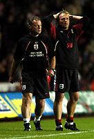 Photo: Richard Lane.<br />Southampton v Bolton Wanderers. FA Barclays Premiership. 25/08/2004.<br />Southampton cartaker manager, Steve Wigley (rt) feels the pressure