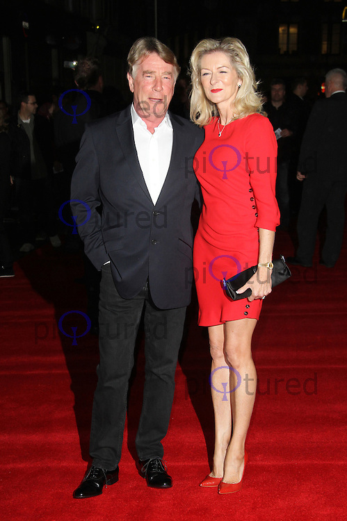 LONDON - OCTOBER 22: Rick Parfitt; Lyndsey Parfitt attended the UK Film Premiere of 'Hello Quo' at the Odeon West End, London, UK. October 22, 2012. (Photo by Richard Goldschmidt)
