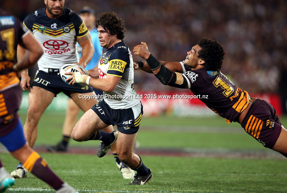 Jake Granville gets past a flying Adam Blair<br /> Broncos v Cowboys NRL Grand Final rugby league match at ANZ Stadium, Homebush Australia. Sunday 4 October 2015. Photo: Paul Seiser/Photosport.nz