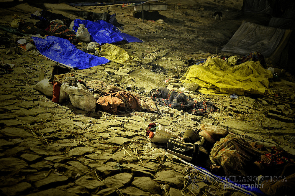 After Holy Bath on Mauni Amawasya day a group of pilgrims, who cannot afford a tent, pass over the night on the banks of Sangam, waiting for the early morning to go back home..