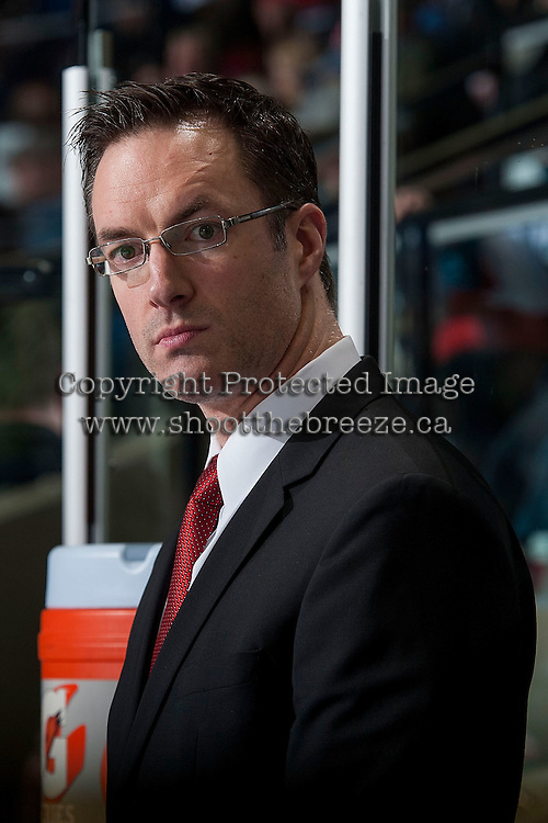 KELOWNA, CANADA - FEBRUARY 6:  Brad Ralph, head coach of the Kelowna Rockets stands on the bench against the Calgary Hitmen on February 6, 2016 at Prospera Place in Kelowna, British Columbia, Canada.  (Photo by Marissa Baecker/Shoot the Breeze)  *** Local Caption *** Brad Ralph;
