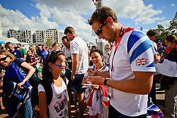 Dylan gets autographs from the Team GB rowing team.