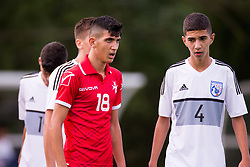 WREXHAM, WALES - Thursday, August 15, 2019: Cyprus' Konstantinos Yiannacou and Malta's Ivin Farrugia during the UEFA Under-15's Development Tournament match between Cyprus and Malta at Colliers Park. (Pic by Paul Greenwood/Propaganda)