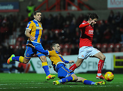 Matthew Sadler of Shrewsbury Town tackles John Goddard of Swindon Town- Mandatory by-line: Nizaam Jones/JMP - 07/01/2017 - FOOTBALL - County Ground - Swindon, England - Swindon Town v Shrewsbury Town - Sky Bet League One