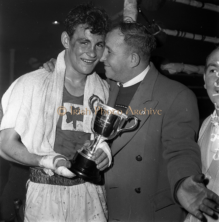 26/01/1962<br /> 01/26/1962<br /> 26 January 1962<br /> Irish, Amateur, National, Junior, Boxing, Championships, at, the National Stadium, Dublin. J. McCormack (Consolata), winner of Light/Heavyweight final with his father.