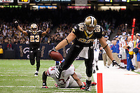 28 November 2011: Tight end (80) Jimmy Graham of the New Orleans Saints catches a pass and runs for a touchdown against the New York Giants during the second half of the Saints 49-24 victory over the Giants at the Mercedes-Benz Superdome in New Orleans, LA.