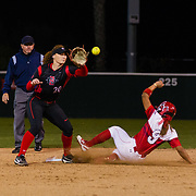 02 March 2018: San Diego State softball closes out day two of the San Diego Classic I at Aztec Softball Stadium with a night cap against CSU Northridge. San Diego State shortstop Shelby Thompson (20) attempts to tag out CSU Northridge infielder Savannah Horvath (9) as she steals second base in the top of the third inning. The Aztecs dropped a close game 2-0 to the Matadors. <br /> More game action at sdsuaztecphotos.com