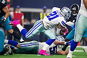 ARLINGTON, TX - OCTOBER 14:  Ezekiel Elliott #21 of the Dallas Cowboys runs the ball in the first half of a game against the Jacksonville Jaguars at AT&T Stadium on October 14, 2018 in Arlington, Texas.  The Cowboys defeated the Jaguars 40-7.  (Photo by Wesley Hitt/Getty Images) *** Local Caption *** Ezekiel Elliott