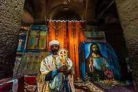 The Lalibela cross is a large, elaborately decorated processional cross, considered one of Ethiopia's most precious religious and historical heirlooms. It is held by the Bet Medhane Alem, the House of the Redeemer of the World, a 12th-century Orthodox underground monolith rock-cut church in Lalibela, Ethiopia.