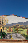 A mural of the Blue Ridge Parkway painted on the side of a building in the tiny village of Burnsville, North Carolina. Burnsville is the start of the Quilt Trail which honors handmade quilt designs of the rural Appalachian region.