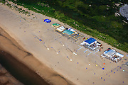 Nederland, Zuid-Holland, Den Haag, 15-07-2012; strandtenten op Noordzeestrand, bij de Oostduinen..Beach restaurants and day trippers on the beach near The Hague..luchtfoto (toeslag), aerial photo (additional fee required).foto/photo Siebe Swart