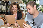 Young couple in an outdoor cafe. Tel Aviv Israel