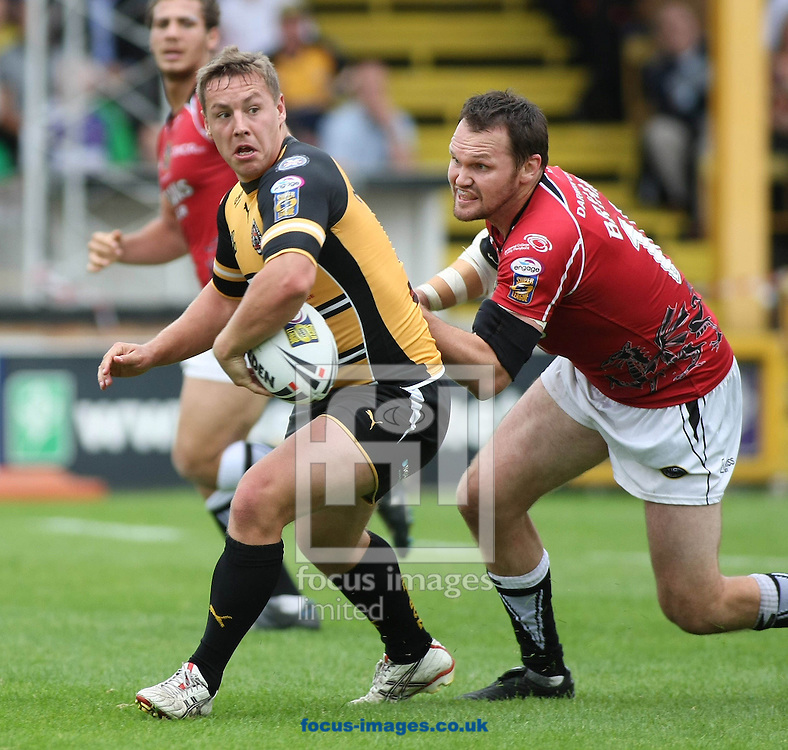 Castleford - Sunday 13th September 2009: Kirk Netherton of the Castleford Tigers is tackled by the Celtic Crusaders Mark Bryant during the Engage Super League match between The Castleford Tigers & The Celtic Crusaders at the Jungle in Castleford. (Pic by Steven Price/Focus Images)