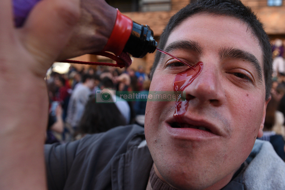 May 5, 2019 - Soria, Soria, Spain - A reveler is seen drinking wine during the celebration..Thousands of people visit the headquarters of the twelve 'Cuadrillas' (associations of revellers) of the city of Soria, north of Spain, to celebrate the 13th century tradition of 'El Catapan'.  They are welcomed with wine, around 7.000 liters, bread, cheese and dry cod. (Credit Image: © John Milner/SOPA Images via ZUMA Wire)
