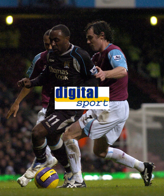 Photo: Olly Greenwood.<br />West Ham United v Manchester City. The Barclays Premiership. 30/12/2006. Manachester City Darius Vassell and West Ham's Christian Dailly