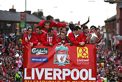 LIVERPOOL, ENGLAND - THURSDAY, MAY 26th, 2005: Liverpool players Luis Garcia, Steve Finnan, Jerzy Dudek, Igor Biscan, Jamie Carragher, Dietmar Hamann, Josemi, John Arne Riise, Steven Gerrard parade the European Champions Cup on on open-top bus tour of Liverpool in front of 500,000 fans after beating AC Milan in the UEFA Champions League Final at the Ataturk Olympic Stadium, Istanbul. (Pic by David Rawcliffe/Propaganda)