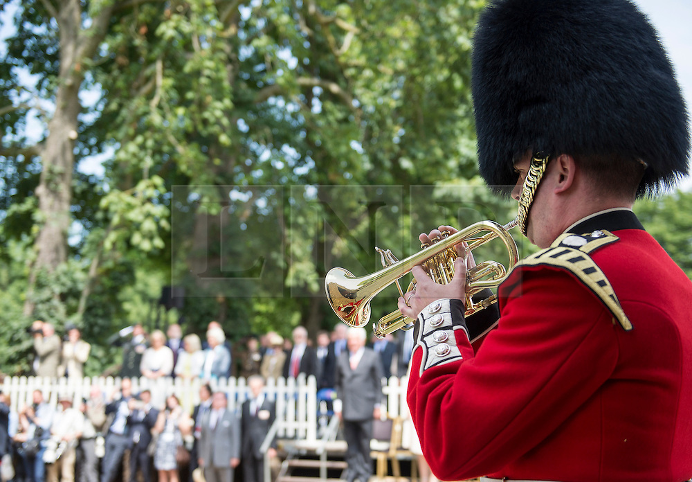 © London News Pictures. 17/06/2015. BELGIUM. <br /> A bugler from the Band of the Coldstream Guards played  the Last Post.. 200 years since the eve of the Battle of Waterloo, Their Royal Highnesses The Prince of Wales and the Duchess of Cornwall attended a special ceremony at Hougoumont Farm, the Belgian Farm Wellington claimed was instrumental in his victory.  Photo credit: Sergeant Rupert Frere/LNP
