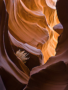 "Flash floods have eroded a slot of Navajo sandstone into a natural cathedral at Lower Antelope Canyon, in Antelope Canyon Navajo Tribal Park, near Page, Arizona, USA. (The older spelling ""Navaho"" is no longer used by the Navajo, an American Indian group who call themselves Diné, or Dineh, ""The People."")"