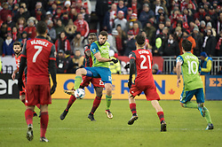 December 9, 2017 - Toronto, Ontario, Canada - Seattle Sounders defender WILL BRUIN (17) controls a pass infant of Toronto FC defender CHRIS MAVINGA (23) while Toronto FC midfielder JONATHAN OSORIO (21) and Seattle Sounders midfielder NICOLAS LODEIRO (10) look on during the MLS Cup championship match at BMO Field in Toronto, Canada.  Toronto FC defeats Seattle Sounders 2 to 0. (Credit Image: © Mark Smith via ZUMA Wire)