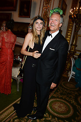 CHARLES DELEVINGNE and his daughter CARA DELEVINGNE at The Animal Ball in aid of The Elephant Family held at Lancaster House, London on 9th July 2013.