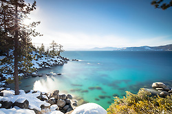"""Boulders at Lake Tahoe 50"" - Long exposure (331 seconds) photograph of snow covered boulders and the blue waters of Lake Tahoe, just north of Sand Harbor."