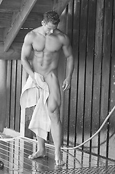 sexy bodybuilder in an outdoor shower