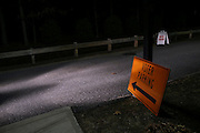 Headlights illuminate the voter parking sign in Tewksbury, MA, Super Tuesday,  Tuesday, March 1, 2016.  CREDIT: Cheryl Senter for The New York Times