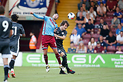 Calgary Soyuncu of Leicester City battles with Lee Novak Of Scunthorpe United during the Pre-Season Friendly match between Scunthorpe United and Leicester City at Glanford Park, Scunthorpe, England on 16 July 2019.
