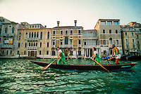 Team rowing a gondola on the Grand Canal, Venice, Italy