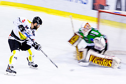22.02.2015, Hala Tivoli, Ljubljana, SLO, EBEL, HDD Telemach Olimpija Ljubljana vs Dornbirner EC, 6. Qualification Round, in picture Nicholas Petrik (Dornbirner EC, #12) Miika Wiikman (HDD Telemach Olimpija, #35) during the Erste Bank Icehockey League 6. Qualification Round between HDD Telemach Olimpija Ljubljana and Dornbirner EC at the Hala Tivoli, Ljubljana, Slovenia on 2015/02/22. Photo by Matic Klansek Velej / Sportida