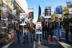 © Licensed to London News Pictures. 20/10/2018. LONDON, UK.Participants carry placards showing politicians and businessmen. Thousands of people take part in a demonstration, organised by the People's Vote campaign, beginning with a march from Park Lane to a rally in Parliament Square.  The People's Vote seeks a referendum on the outcome of the final Brexit negotiations ahead of 29 March 2019, the date that the UK is due to leave the EU.  Photo credit: Stephen Chung/LNP