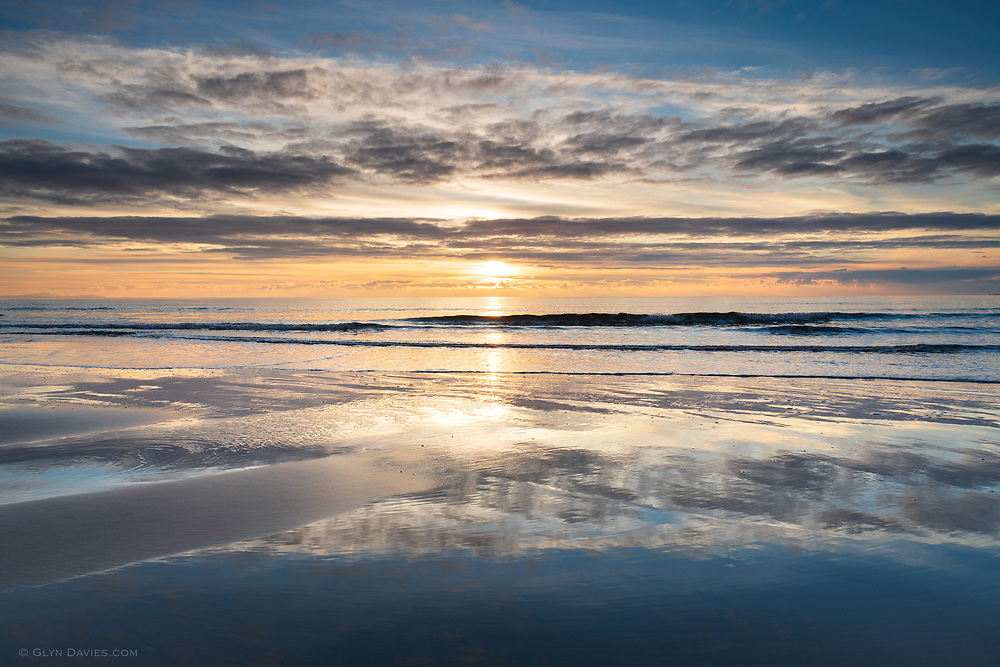 When the magical, and literally 'awesome' moments of sunset mirror in virginal wet sand, it's quite genuinely hard to beat. Double the beauty, double the drama, double the emotional response. It's just a beach, the sea and a ball of gas, so why is it that we as humans are so drawn to these simple elements when combined?