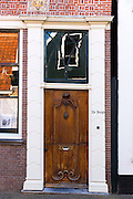 Quaint traditional wooden brown front door entrance doorway in the town of Edam, The Netherlands