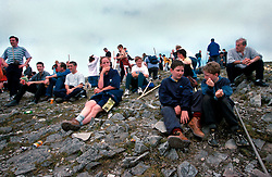 IRELAND CO. MAYO CORAGH PATRICK JUL99 - Pilgrims rest on top of Croagh Patrick mountain in western Ireland.  Around 25,000 people, some of which are bare-footed, participate in this pilgrimage to the top of Croagh Patick mountain on the last Sunday of July from where in 441 A.D. St. Patrick supposedly sent Ireland's reptiles to their doom. ..jre/Photo by Jiri Rezac..© Jiri Rezac 1999..Contact: +44 (0) 7050 110 417.Mobile: +44 (0) 7801 337 683.Office: +44 (0) 20 8968 9635..Email: jiri@jirirezac.com.Web: www.jirirezac.com..© All images Jiri Rezac 1999 - All rights reserved.