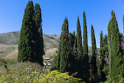 Church of Saint Nikolaos Petra and belfry belltower among cypresses  in village of Old Perithia - Palea Perithea, Corfu,  Greece
